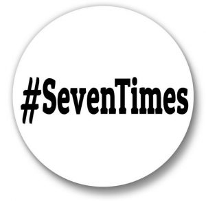 Button showing black text that reads #SevenTimes